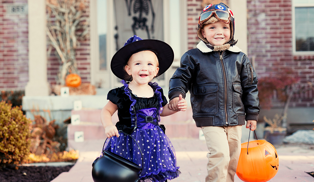two kids dressed up for halloween