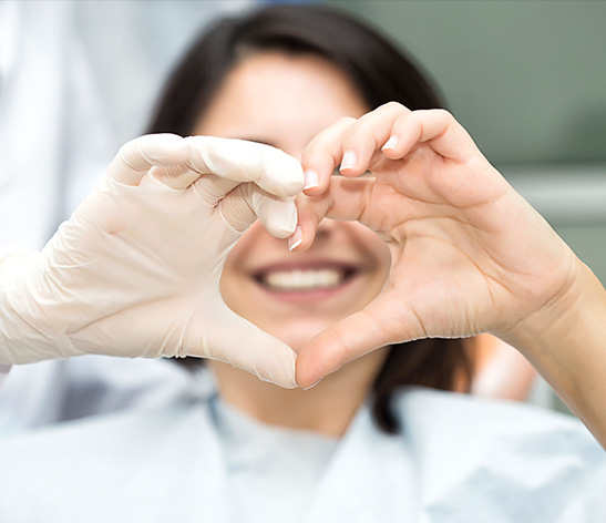 doctor making a heart with her hands