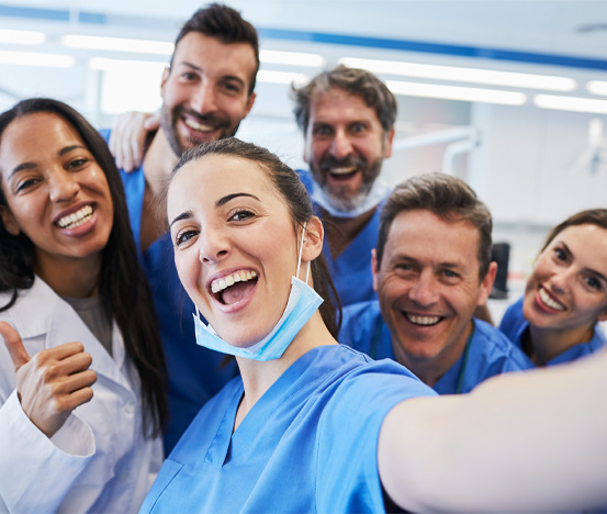 Doctor and hygienists taking a selfie
