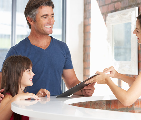 Man and child at front desk