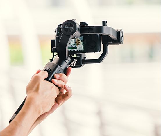 Individual holding a camera