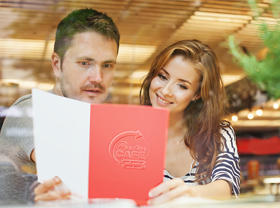 Couple looking at menu