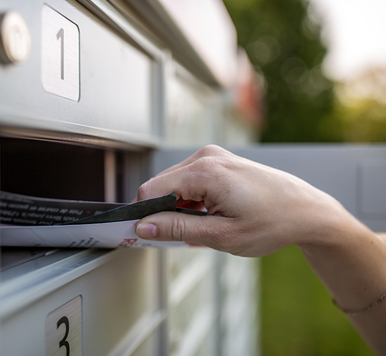A person getting their mail