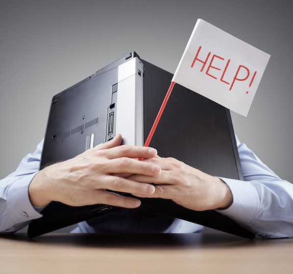 person holding a laptop with a sign that says help!