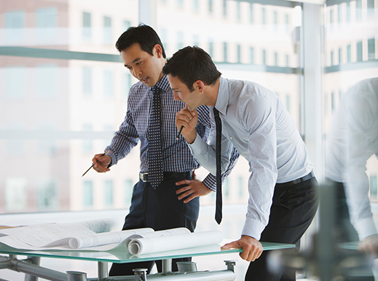 Two business men strategizing