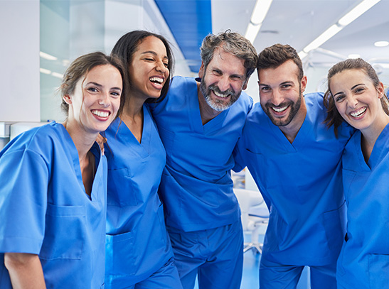 Group of individuals wearing scrubs