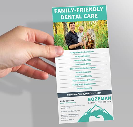 Hand holding brochure