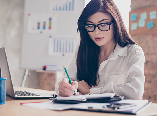 Woman with glasses doing her finances