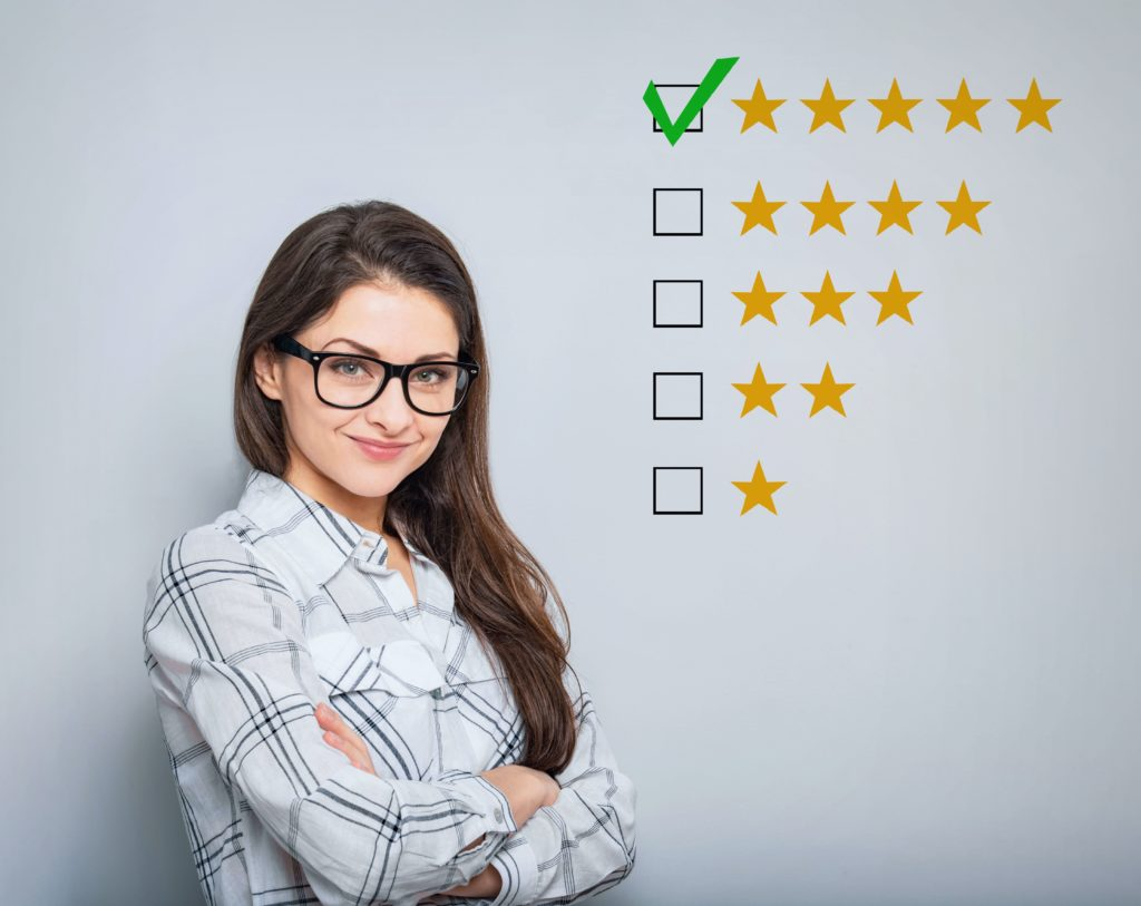 Lady standing next to 5-star review symbol