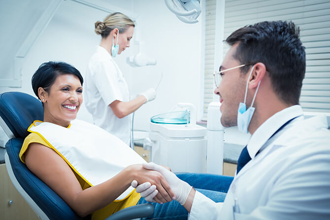 dentist shaking a patient's hand